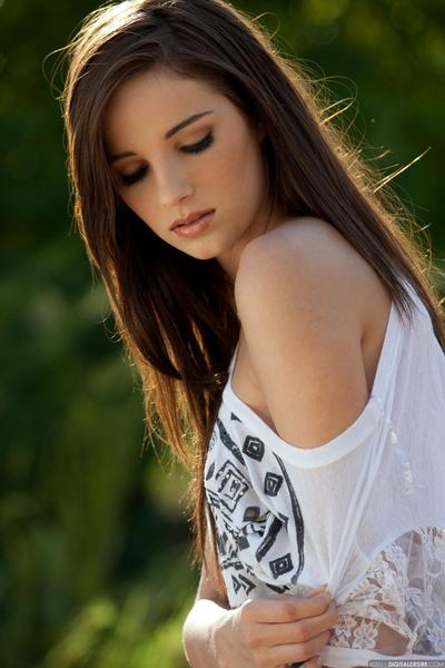 Charming teen brunette Madison Spears demonstrates her lovely undersize tits outdoors
