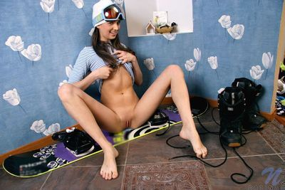 Leggy teen dark brown Polina Phrolova with compact wazoo and bald wet crack removes her blue shorts
