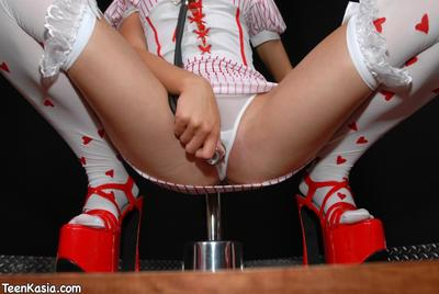 Tight shaved pussy pole dancer Teen Kasia in red heavy shoes strips out of her uniform