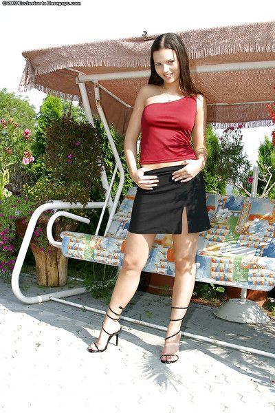 Fabulous amateur brunette babe Eva is undressing in her backyard