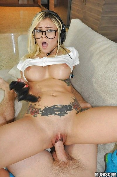 Rounded glasses clad Latina gamer gal Marsha May taking facial cumshot