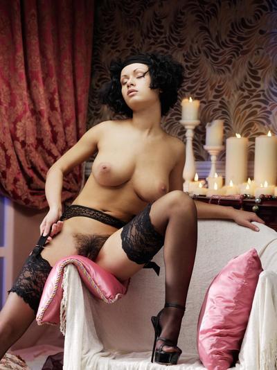 Curvy bimbo Pammie Lee demonstrates the beautiful hairy pussy between legs in black