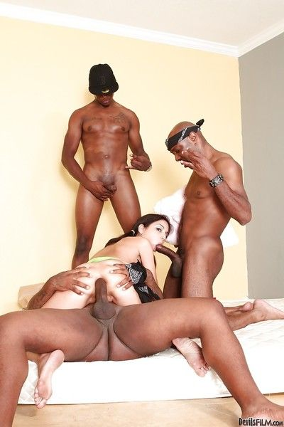 Trinity St. Clair is the center of attention in interracial group sex