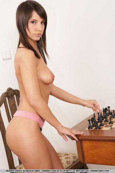 Flirtatious young breathtaker Monika Vesela with long slender legs poses naked