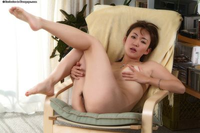 Amateur Asian young Kuki demonstrates her bushy cum-hole in close up