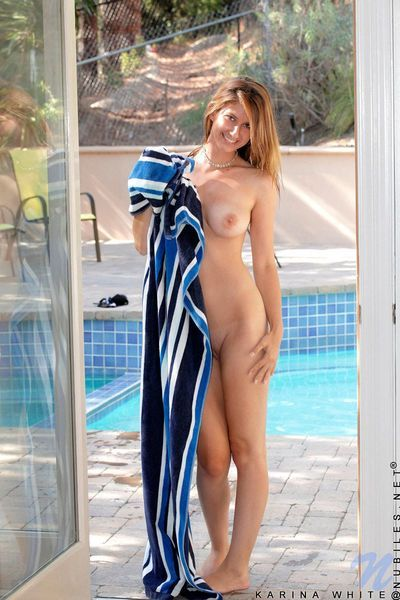 Titsy adolescent chick Karina White expands her shaved pussy open in the pool