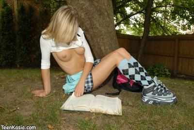 Rigid schoolgirl Teen Kasia in mini short skirt flashes her g-string and tits outside