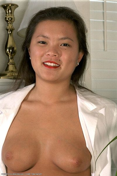Teen Asian adolescent Tina unveiling nice boobs and beaver while undressing