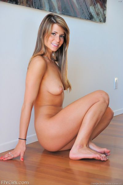 Mali plays naughty while being nude and horny during top solo