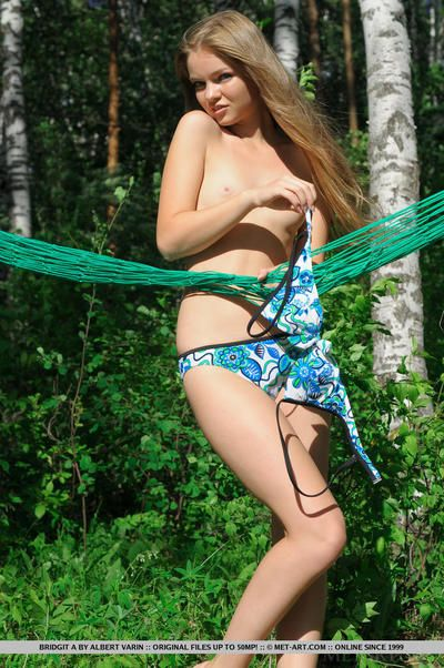 Cute blonde diet teen Bridgit A spreading to show undressed uterus outdoors