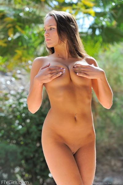 Utterly naked Teal FTV spreads her butt cheeks and stretches her clits