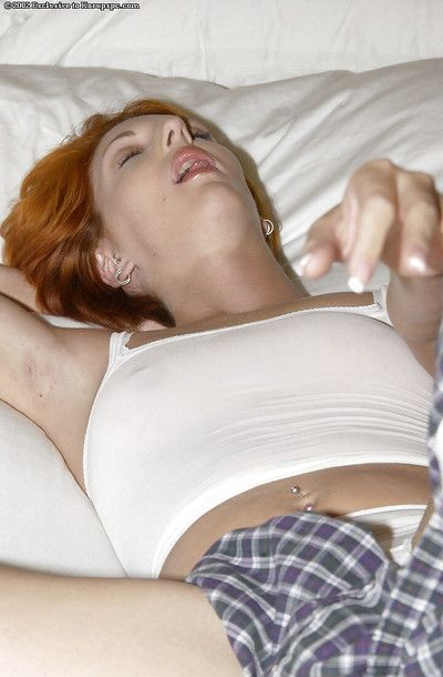 Fascinating redhead model with big milk cans Lydie undressing on the daybed