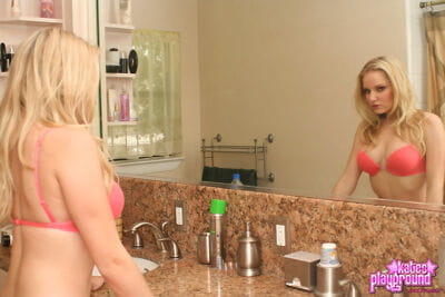 Blonde juvenile takes off her matching bra and panty combo in shower-room