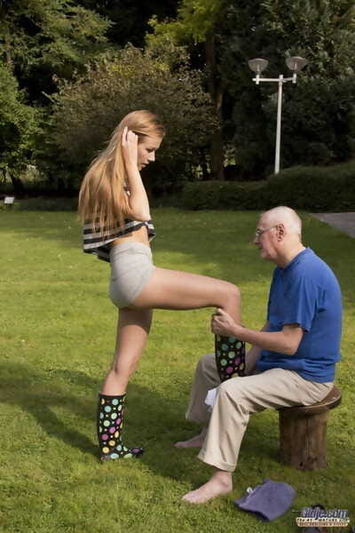 Skinny infant lass has sex with a really grandpapa in penis coverer boots