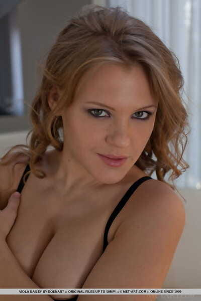 Sexy young beauty with heavy tits Viola takes her clothes off not including her underclothes