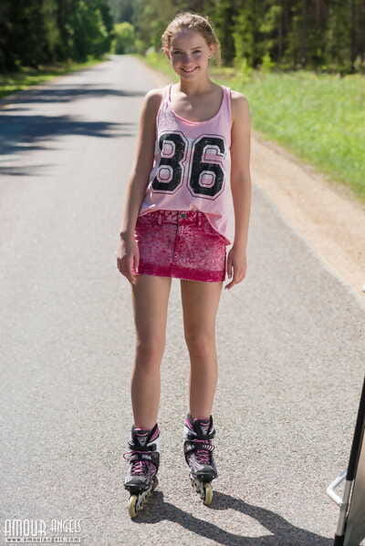 Young blonde girl Faina attains naked in middle of road wearing roller blades