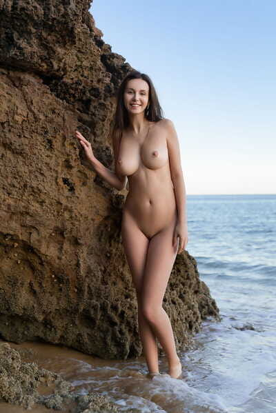 Solo lass Alisa I wanders a sandy shoreline while showing her cute body