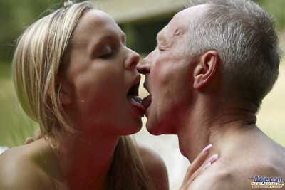 Naked young blonde goes for some oldman cock swallowing & scrotum licking outdoors