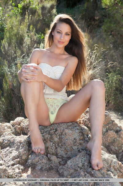 Erotic angel Lorena B flaunting little melons & hairy cage of love in bare feet outdoors