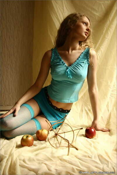Beautiful blonde teen with firm melons case without clothes other than blue hosiery