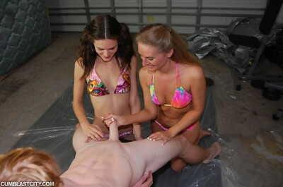 Dark hair teen girl in bikini sharing a hard cock with her melodious friend