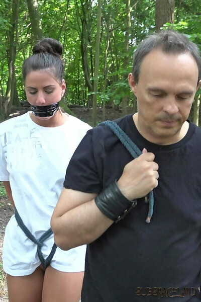 Infant brunette slave is disciplined and bonked in the forest by her Master