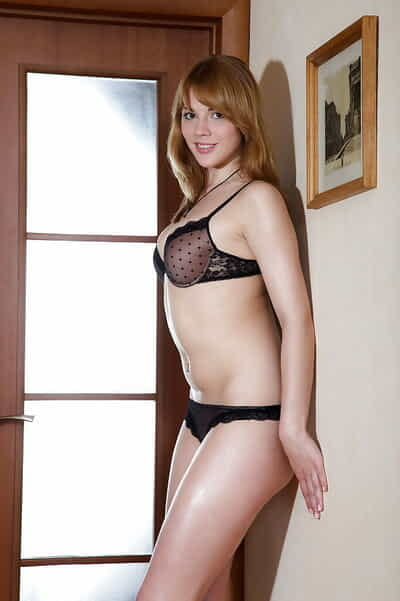 Sexy redhead lass Sarah M erotic dancing and showing her wavy muff