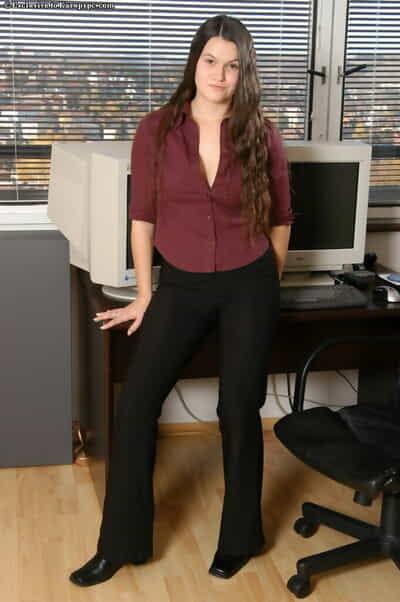 Clothed brunette Denisa is revealing her juvenile amateur body on camera