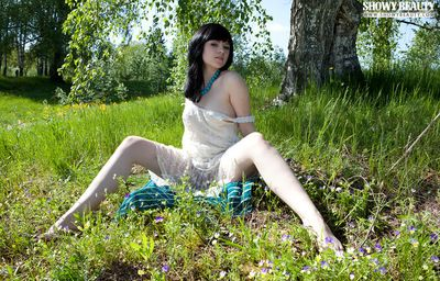 Dark haired infant model embarks on her legs to drip a shiny on top pussy outdoors