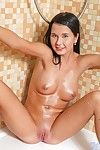 Alive brunette Mia Manarote spreads her legs and rubs her shaved twat in the shower