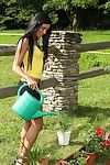 Sweet village girl Ashley Bulgari with tan skin and smooth head uterus plays with she\'s outdoors