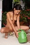 Teen brunette hair Amia Moretti can\'t keep her hands away from the pink even when she waters the flowers