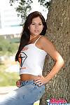 Darksome haired amateur Shyla Jennings poses non nude in cropped shirt and blue jeans