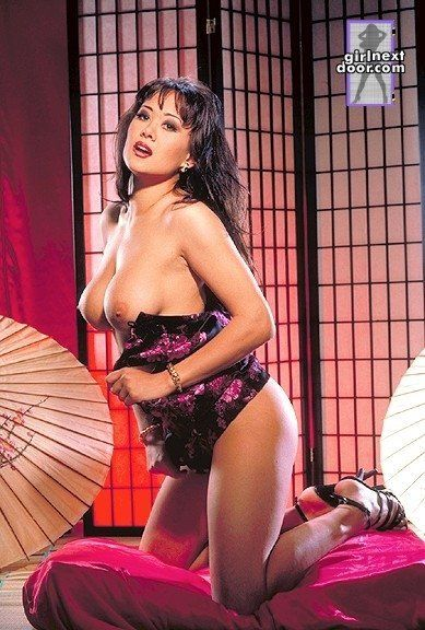 Boobsy eastern in high heels Asia Carrera takes off her cute suit and strings