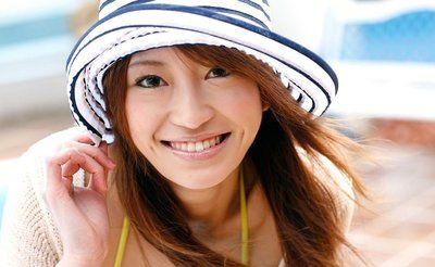 Good-looking charming Yu Saotome covered in extreme hat and blouse is demonstrating her beautiness outdoors and in car