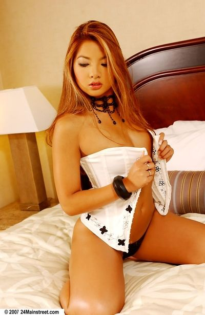 Pornstar redhead Jenny Chu way in her untamed underclothes on her knees
