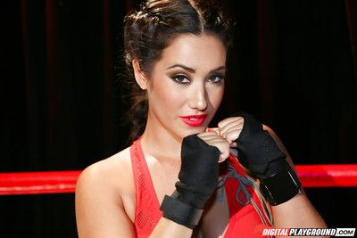 Chinese pornstar Eva Lovia posing uncovered in boxing ring wearing brown boots