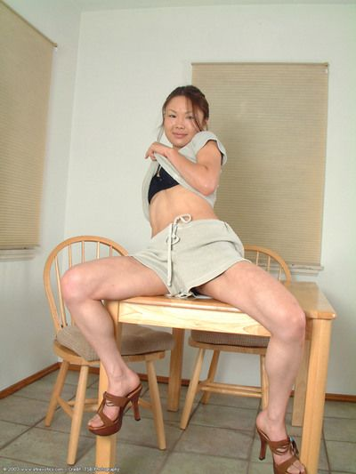 Korean number 1 timer Lilianna slipping strings over stripped legs in kitchen