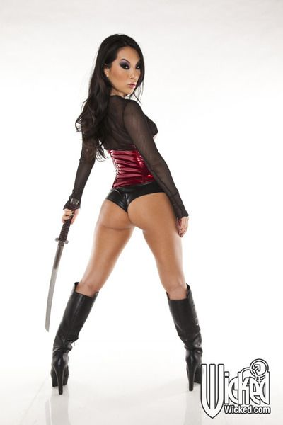 Oriental darling with massive milk shakes Asa Akira looks enticing in intimidating sexy pants with singletail in hands