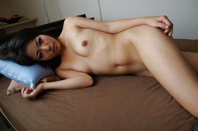 Oriental amateur Nao Miyazaki undressing and exposing her vagina in close up