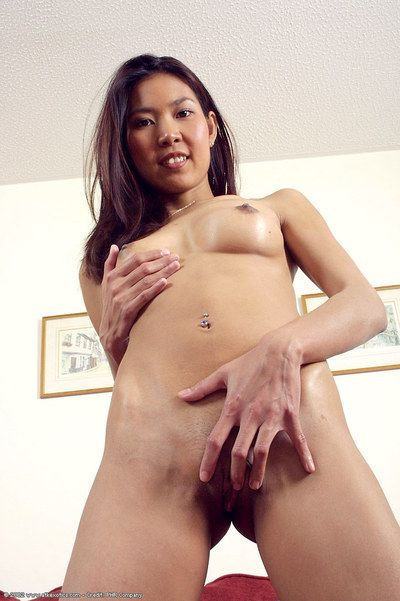 Skinny Chinese adolescent Luxi exposing pink cage of love later on undressing