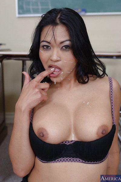 Cuddly Japanese milf Mika Tan posing in high heels and hammering at school