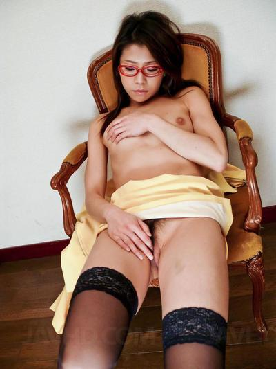 Pretty Oriental with glasses Mizuki Ogawa hands out blow job and enjoys gangbang