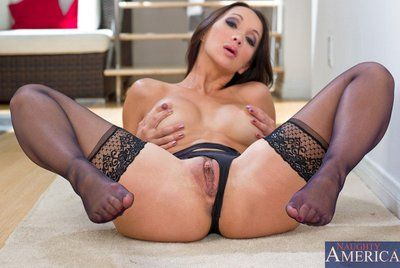 Sexually aroused Japanese MILF Katsuni is expanding her legs wide to show that pink slippery cunt.