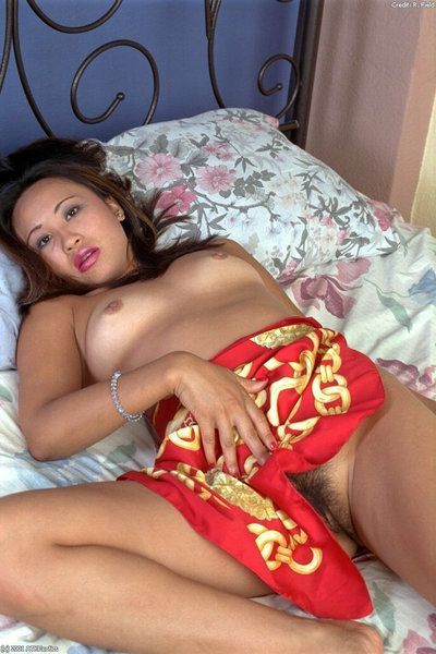 Japanese youthful Dirty undressing on couch in advance of delving fingers admires pussy