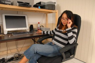 Blatant Chinese beauty Keeani Lei is erotic dancing and showing body in the office