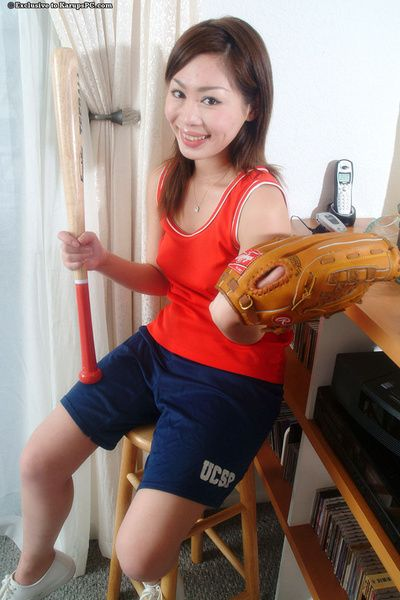 Brown hair Oriental youthful Yumi teases her youthful cage of love with a bat