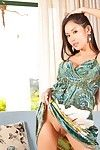 Leggy oriental cutie Davon Kim with natty cage of love takes off her clothing and shoes