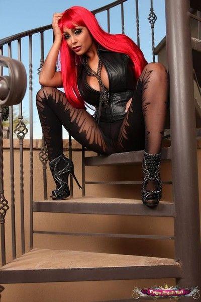 Priya rai in a in flames wig and black body stocking