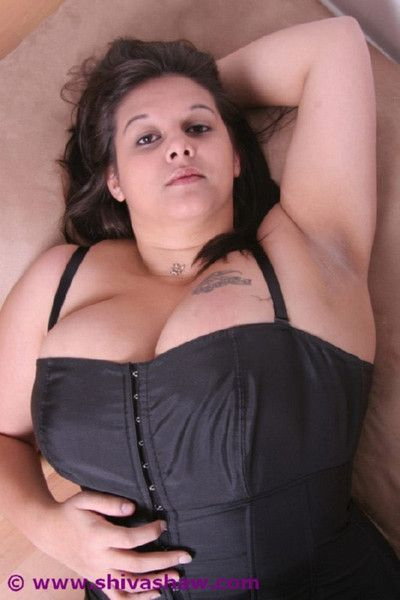 Big indian beside chunky boobs close by tight corset and stockings